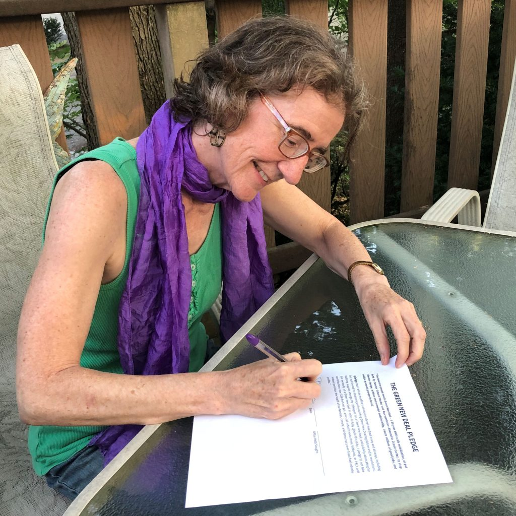 Patty signs the Green New Deal Pledge